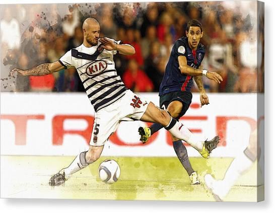 Zlatan Ibrahimovic Canvas Print - Di Maria  Kicks The Ball  by Don Kuing