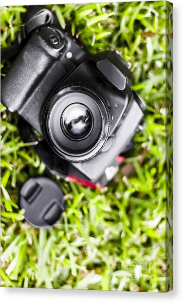 Electronic Instruments Canvas Print - Digital Slr Camera On Green Grassy Field by Jorgo Photography - Wall Art Gallery