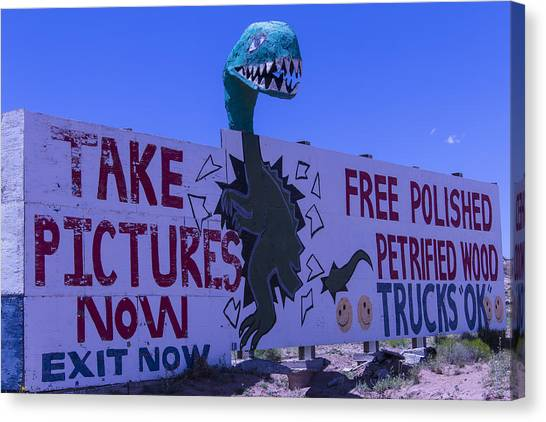 Timeworn Canvas Print - Dinosaur Sign Take Pictures Now by Garry Gay