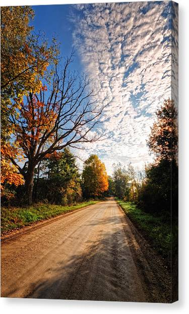 Canvas Print featuring the photograph Dirt Road And Sky In Fall by Lars Lentz