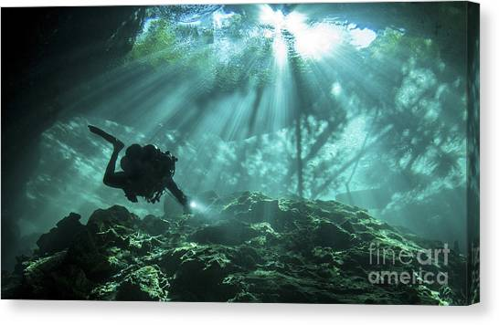 Spelunking Canvas Print - Diver Passes Through Light Beams by Karen Doody