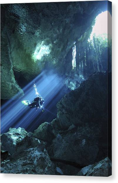 Underwater Caves Canvas Print - Diver Silhouetted In Sunrays Of Cenote by Karen Doody