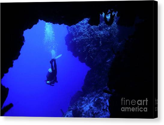 Underwater Caves Canvas Print - Diver Swimming Out Of A Cave by Sami Sarkis