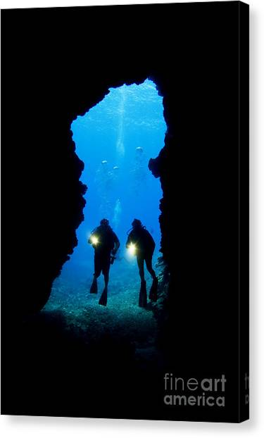 Underwater Caves Canvas Print - Divers Silhouetted Through Reef by Dave Fleetham - Printscapes