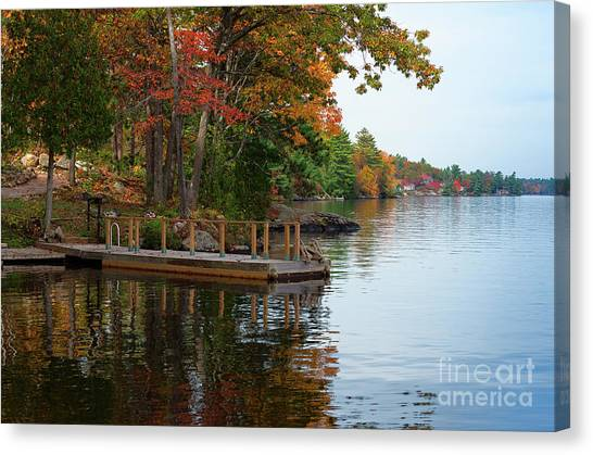 Dock On Lake In Fall Canvas Print