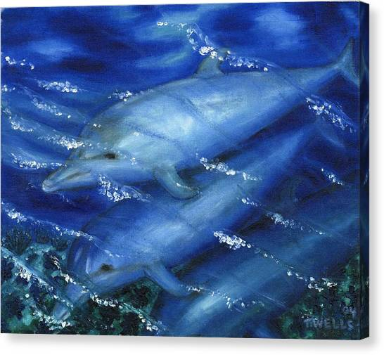 Dolphins Swimming Canvas Print by Tanna Lee M Wells