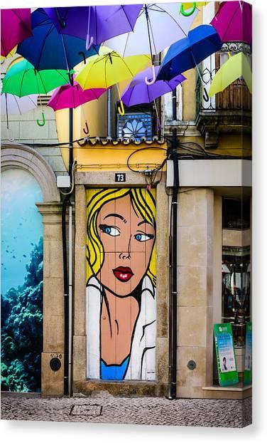 Door No 73 And The Floating Umbrellas Canvas Print