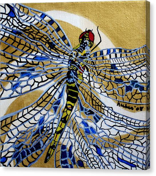 Dragonfly On Gold Scarf Canvas Print by Susan Kubes