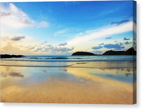 Sunset Horizon Canvas Print - Dramatic Scene Of Sunset On The Beach by Setsiri Silapasuwanchai