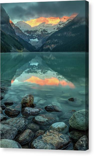 Canvas Print featuring the photograph Dramatic Sunrise At Lake Louise by Pierre Leclerc Photography