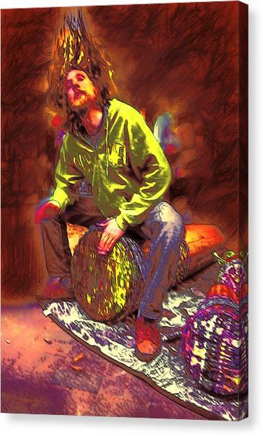 Drummer On Fire Canvas Print by John Haldane