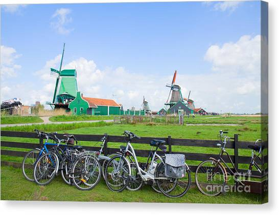 dutch windmills with bikes in Zaanse Schans Canvas Print