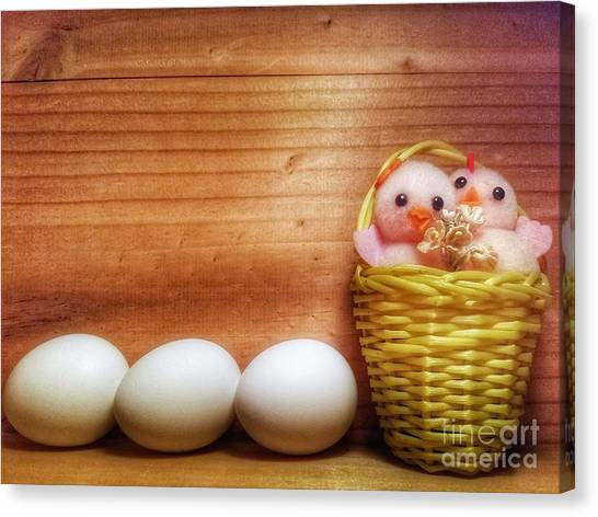 Easter Basket Of Pink Chicks With Eggs Canvas Print