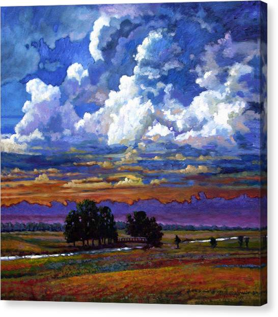 Prairie Sunsets Canvas Print - Evening Clouds Over The Prairie by John Lautermilch