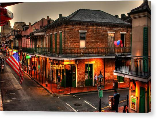 Street Signs Canvas Print - Evening On Bourbon by Greg and Chrystal Mimbs