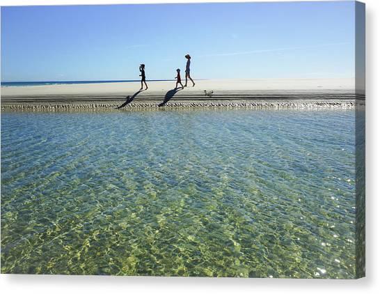 Exploring A Tidal Beach Lagoon Canvas Print