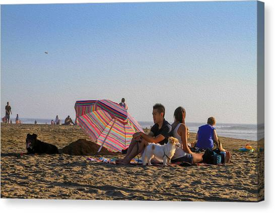 Family At Ocean Beach With Dogs Canvas Print