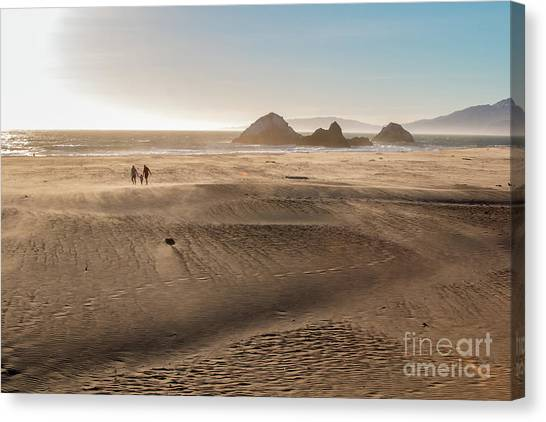 Family Walking On Sand Towards Ocean Canvas Print