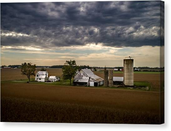 Farmstead Under Clouds Canvas Print