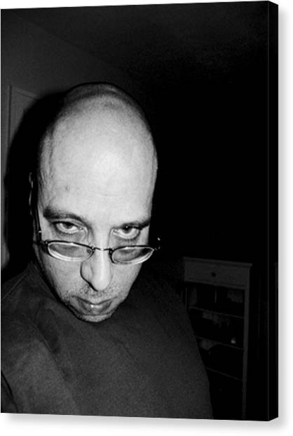Fat Bald And Unhappy Canvas Print by John Toxey