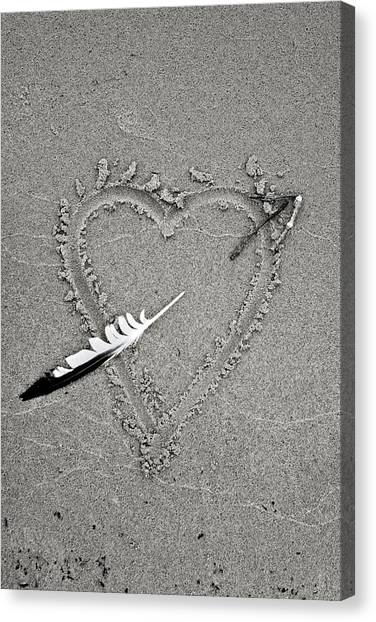 Feather Arrow Through Heart In The Sand Canvas Print