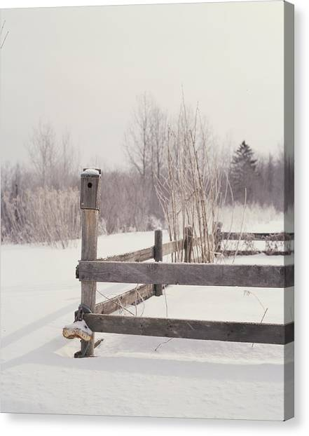 Fence And Birdhouse In The Snow Canvas Print by Gillham Studios