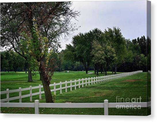 Fence On The Wooded Green Canvas Print