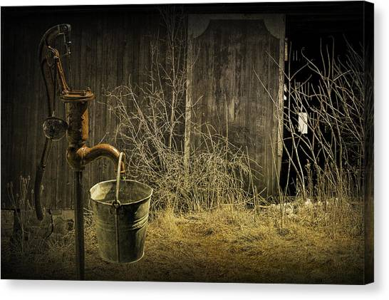 Fetching Water From The Old Pump Canvas Print