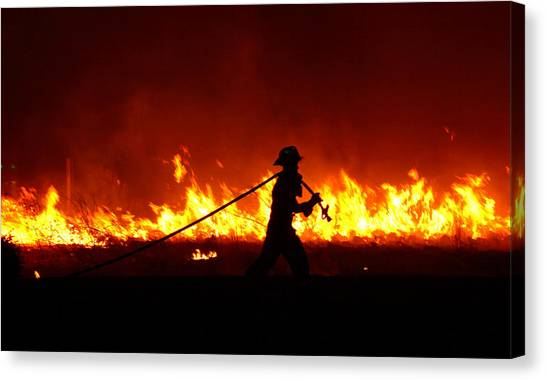 Fighting The Fire Canvas Print