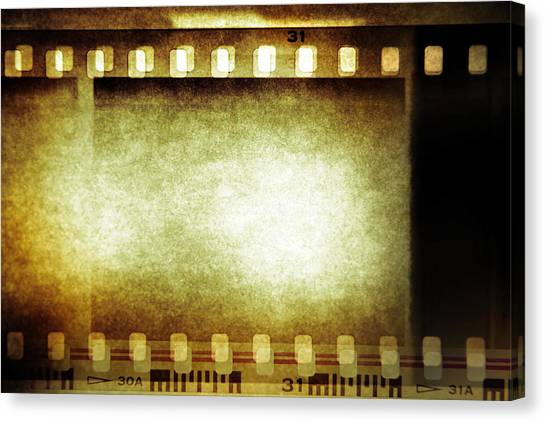 Movies Canvas Print - Filmstrip by Les Cunliffe