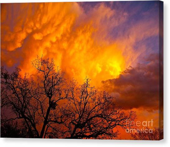 Fire And Water In The Sky Canvas Print by Chuck Taylor