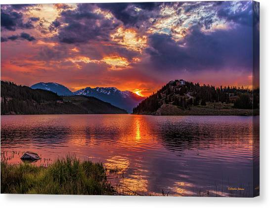 Fire On The Water Reflections Canvas Print