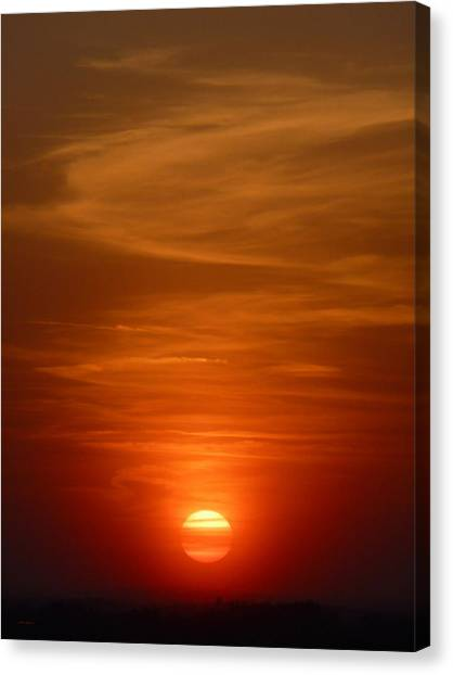 Fireball At Sunset Canvas Print by Tim Mattox