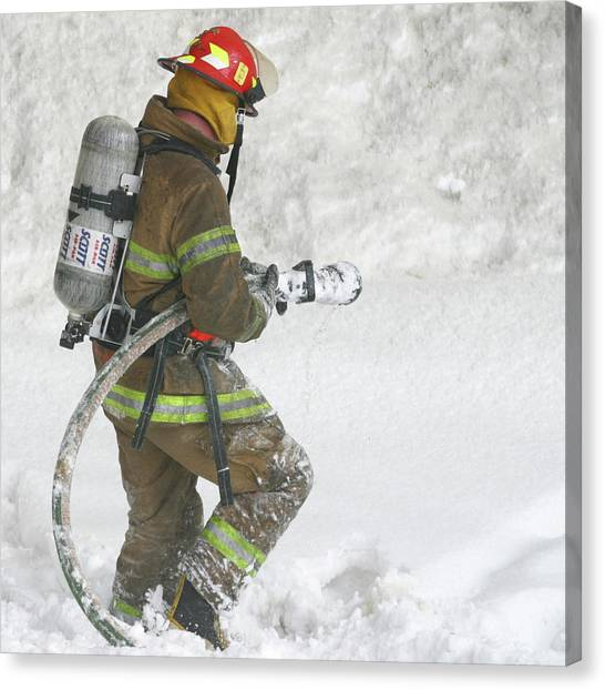 Firefighter In The Snow Canvas Print by Jack Dagley