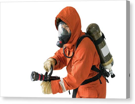 Volunteer Firefighter Canvas Print - Firefighter In Uniform With Isolated by Anek Suwannaphoom