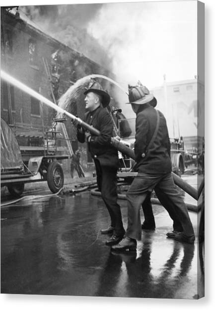 Hard Hat Canvas Print - Firemen With Hose by Underwood Archives