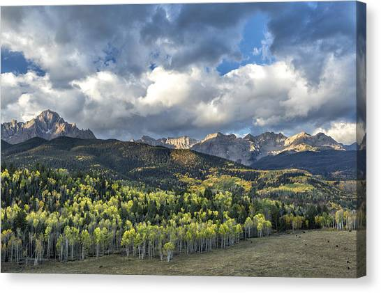 Canvas Print featuring the photograph First Light On The Sneffels Range by Denise Bush