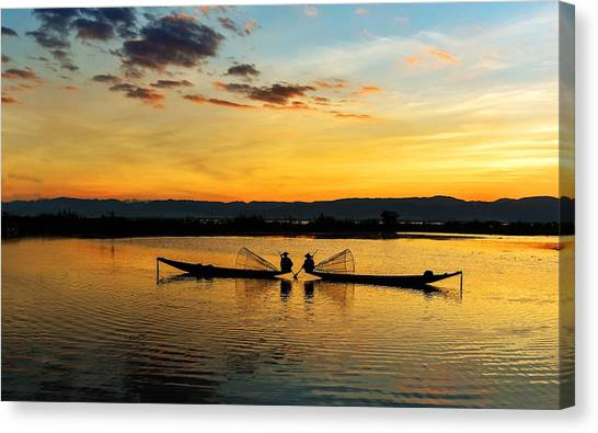 Canvas Print featuring the photograph Fisherman On Their Boat by Pradeep Raja Prints