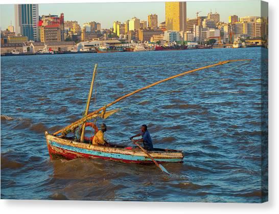 Fishermen Rowing Near Maputo Canvas Print