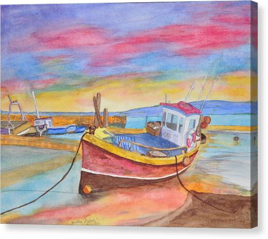 Fishing Boat At Low Tide Canvas Print by Jonathan Galente