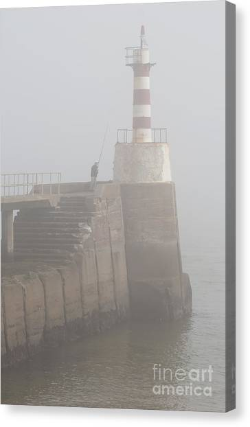 Fishing In The Mist. Canvas Print by John Cox