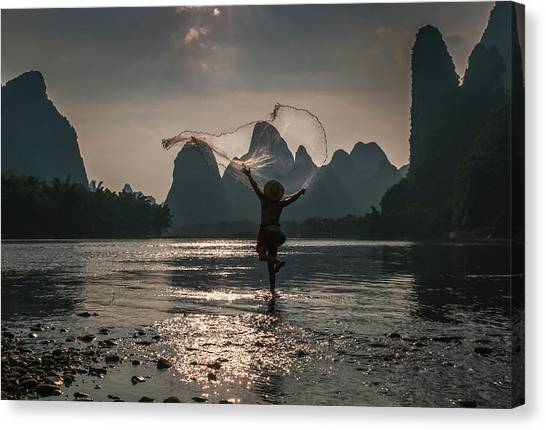 Fisherman Casting A Net. Canvas Print