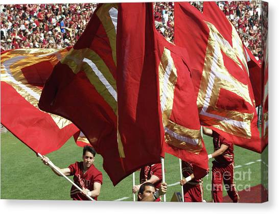 Flag Huddle Canvas Print by Allen Simmons