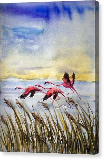 Flamingoes Flight Canvas Print
