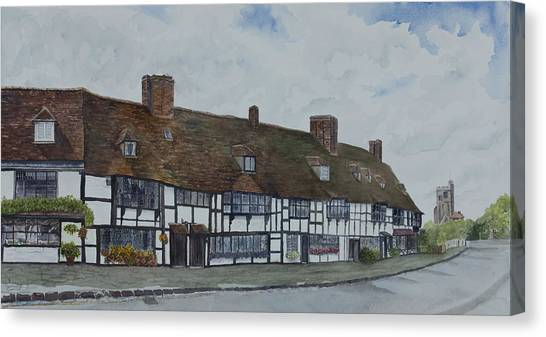Flemish Weavers Cottages England Canvas Print by Debbie Homewood
