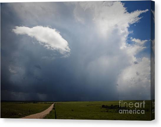 Flint Hills Rain Canvas Print by Fred Lassmann