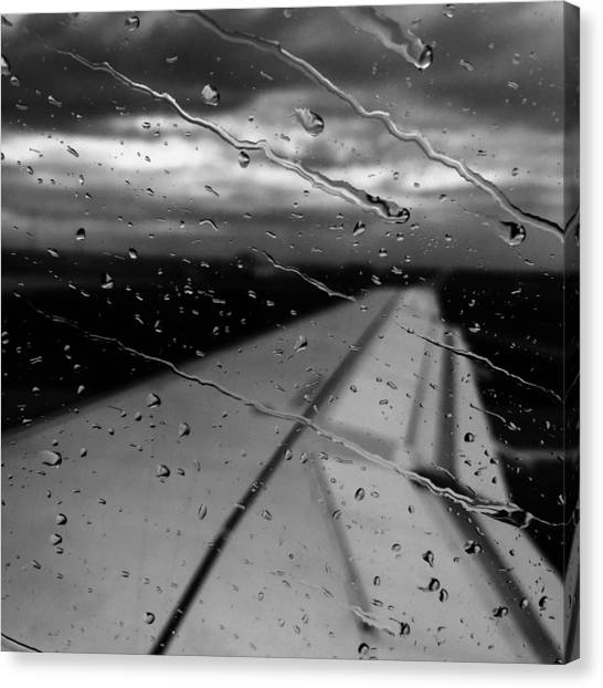 Canvas Print featuring the photograph Fly Away On A Rainy Day by Chris Feichtner