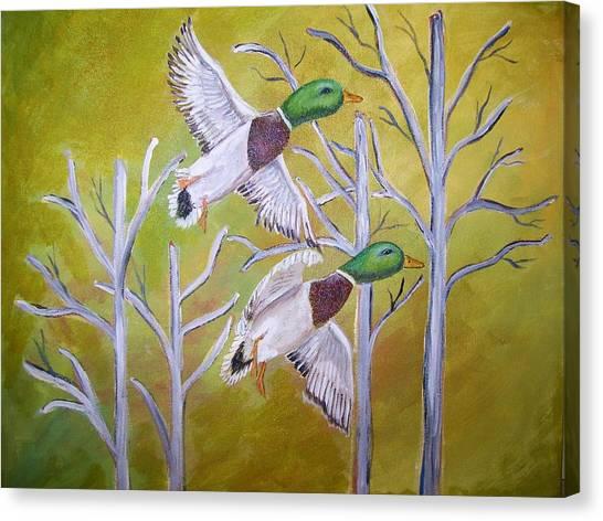 Flying Mallards Canvas Print