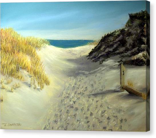 Footprints In The Sand Canvas Print by Joan Swanson
