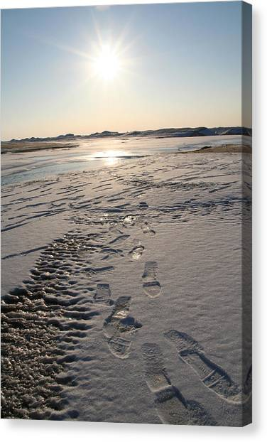 Footsteps In Frozen Landscape Canvas Print by Christopher Purcell